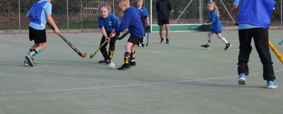 Supervised children playing hockey at London Road Pavilion, Louth Lincolnshire